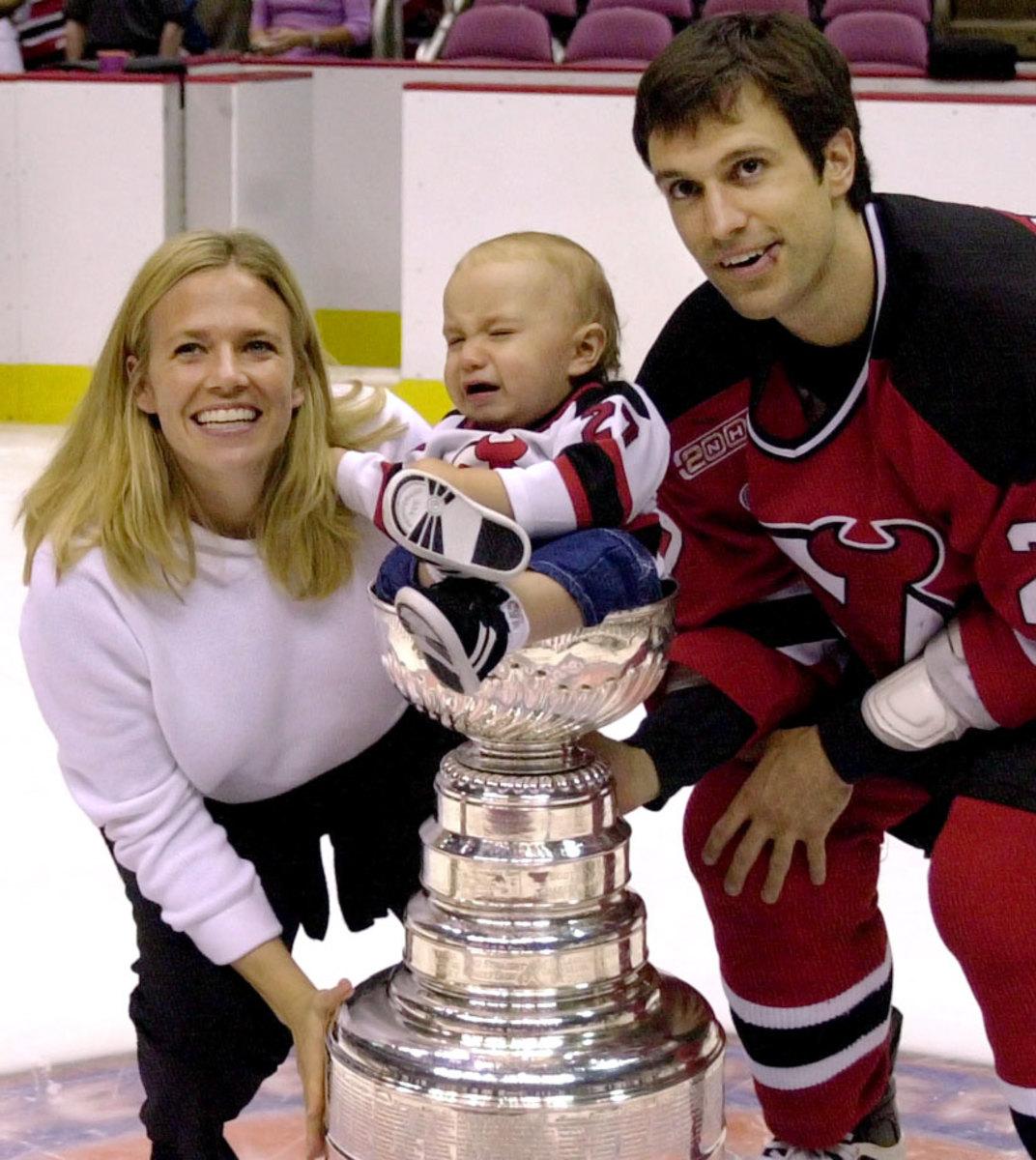 2000-Scott-Niedermayer-wife-Lisa-son-Logan-Stanley-Cup.jpg