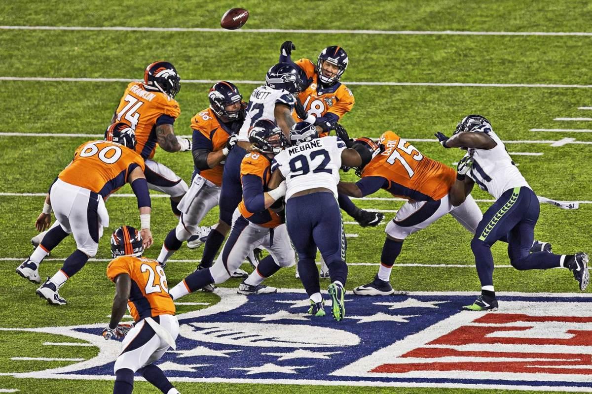 2014-0202-Super-Bowl-XLVIII-Peyton-Manning-Michael-Bennett-op6o-18642.jpg