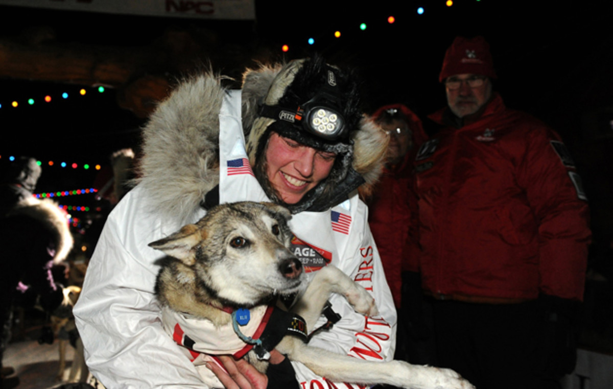 Zirkle with her lead dog after finishing in second place behind race winner Dallas Seavey in the 2014 Iditarod.