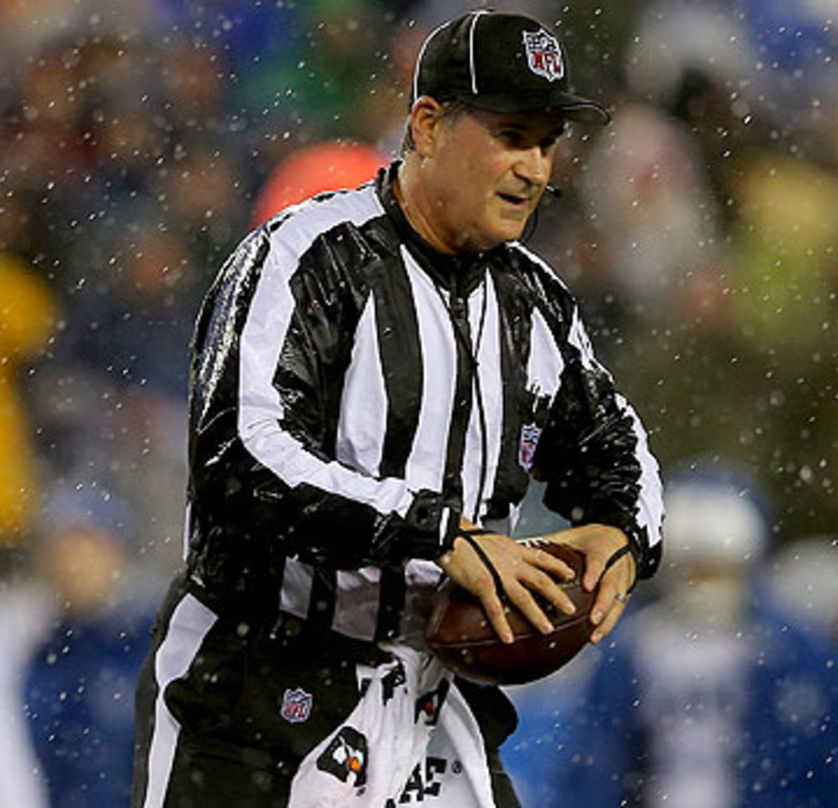 Inclement conditions can adjust the amount of footballs the refs use during games. (Elsa/Getty Images)
