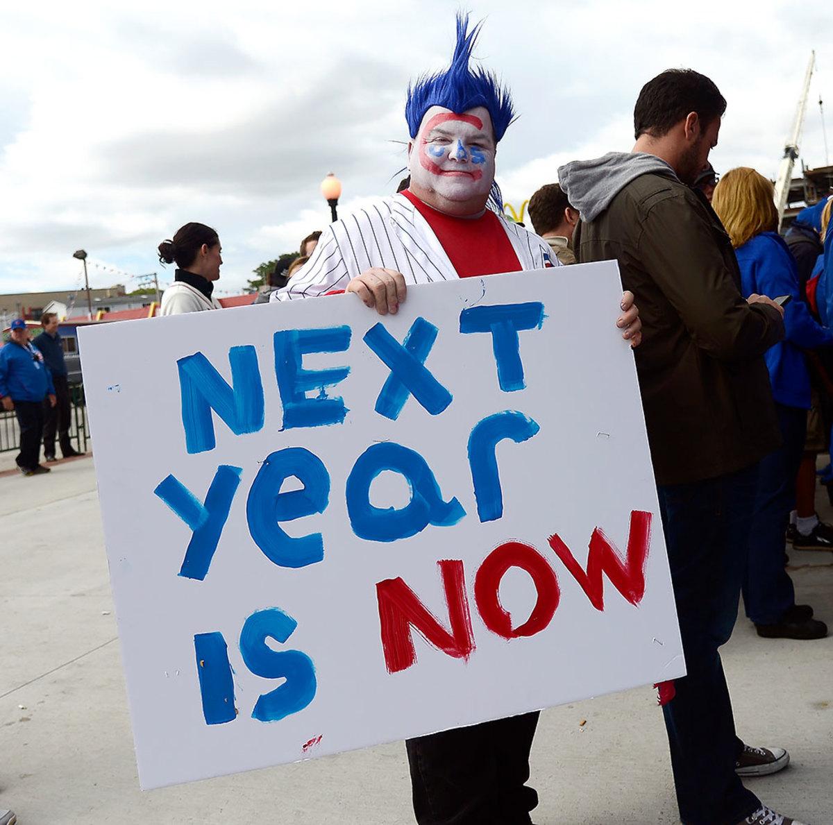 2015-Chicago-Cubs-fan-sign-Chicago-Cubs-fan-sign-GettyImages-492477900.jpg