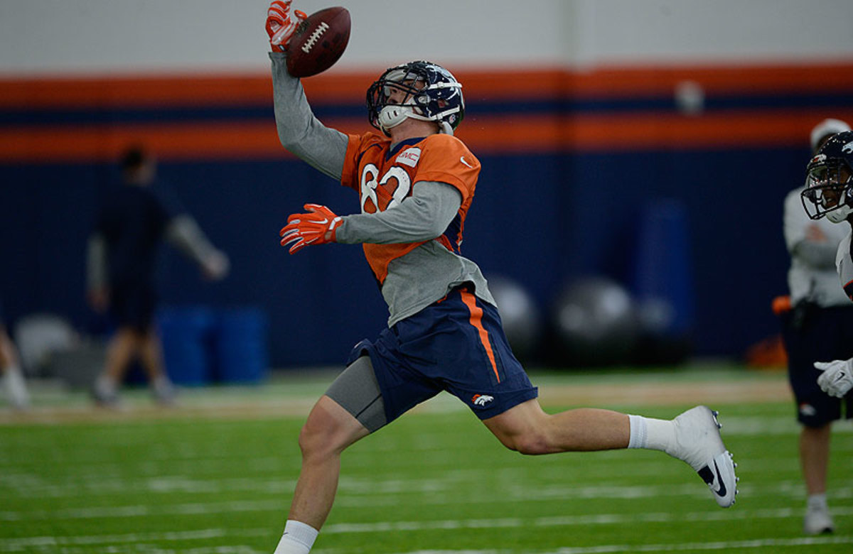 Jeff Heuerman tries to haul in a pass during the Broncos minicamp Friday. Later in the session, the rookie tight end tore his ACL and will be out until 2016. (John Leyba/Getty Images)