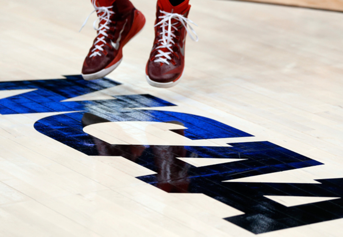 ncaa-logo-basketball-player.jpg