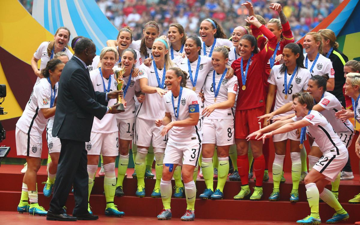 rampone-receives-world-cup-trophy.jpg