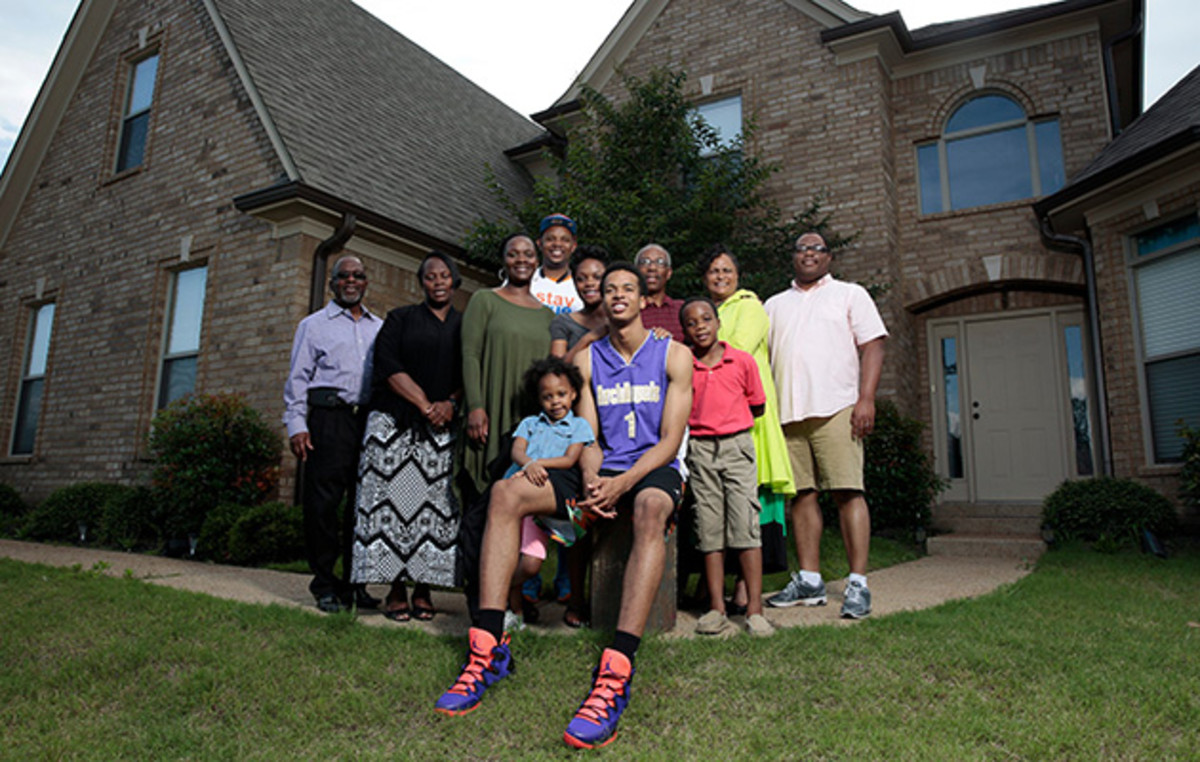 The foundation started by Gerald Hamilton (with glasses) has brought his family under scrutiny.