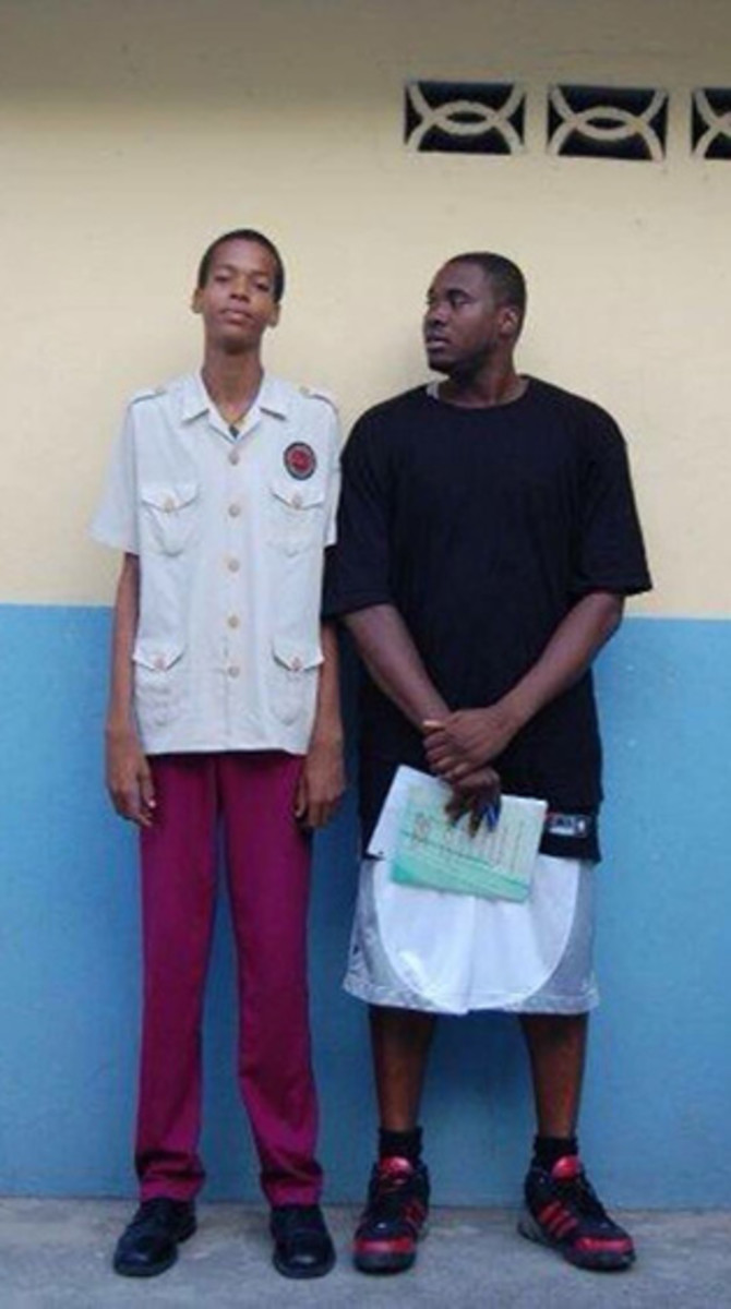 Labissiere, at age 13, stands with Pierre Valmera at Quisqueya Christian School in Port-au-Prince in Dec. 2009.