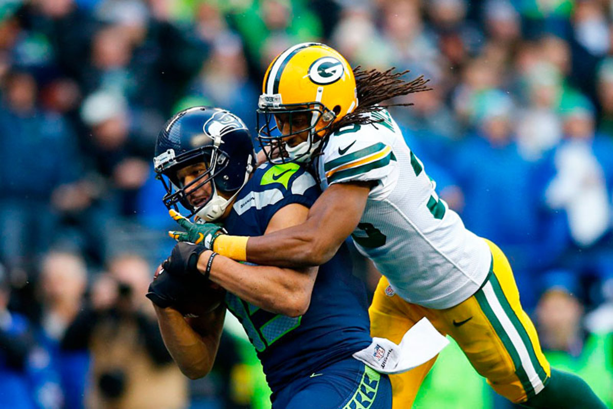 Kearse caught the ball beyond Williams and hung on for dear life. (Jonathan Ferrey/SI/The MMQB)