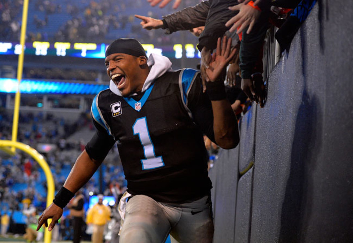Newton celebrating the Panthers' overtime victory against the Colts.