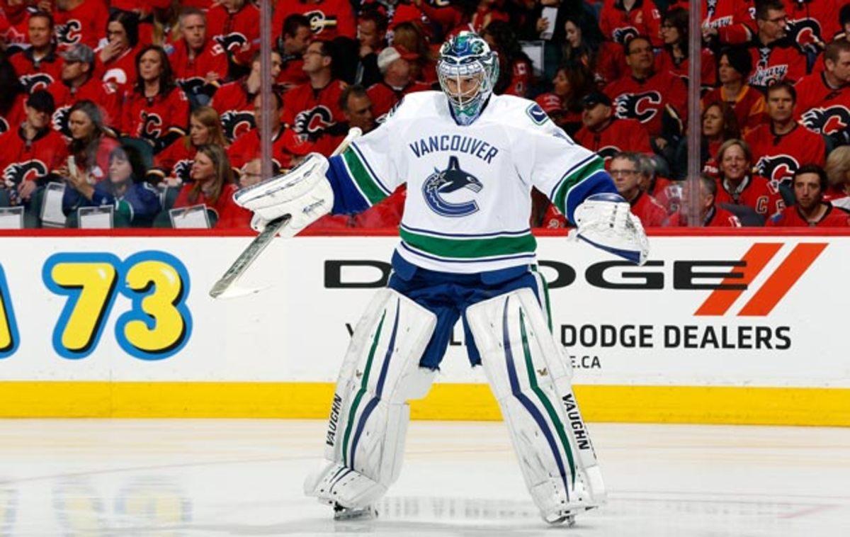 Ryan-Miller-Gerry-Thomas-NHLI.jpg