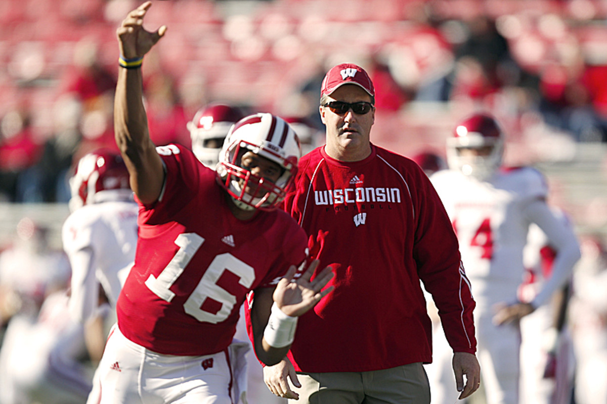 Chryst watches as Wilson warms up before a game in 2011. (Andy Manis/AP)