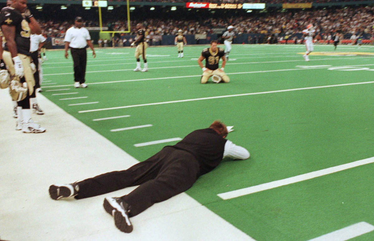 Summing up Ditka's tenure in New Orleans: The coach lies sprawled on his stomach after a loss to the Browns on a Hail Mary in 1999. Ditka was 15-33 in three seasons with the Saints.