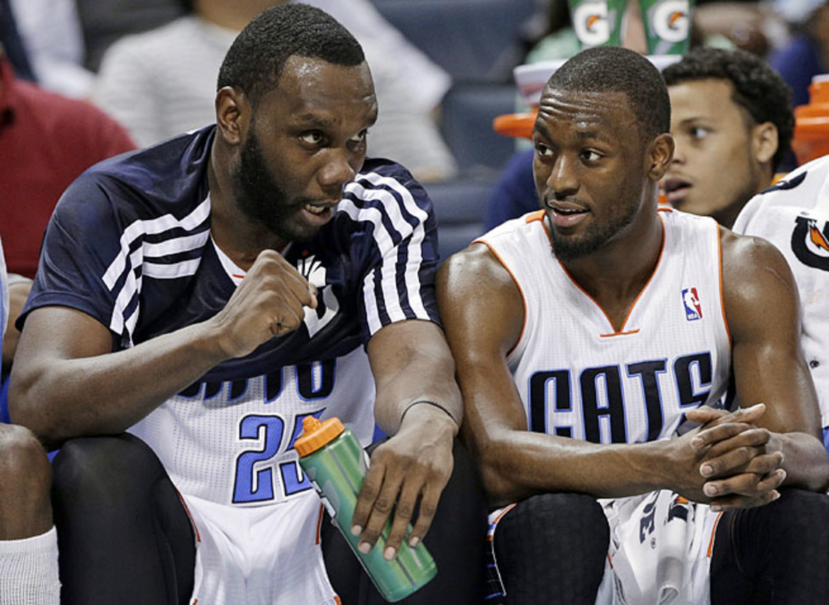 Guard Kemba Walker (right) recruited Al Jefferson to Charlotte to help guide the young Bobcats.