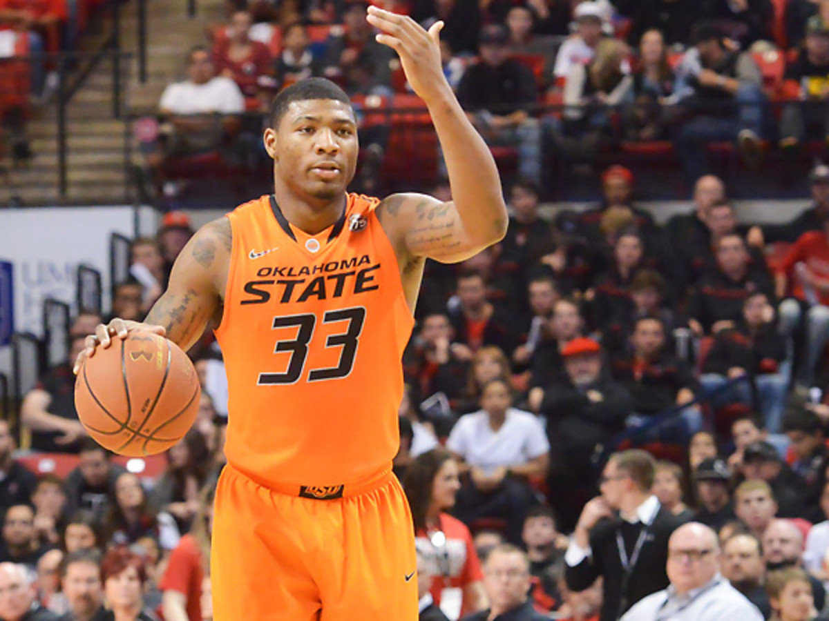 Marcus Smart will sit three games after he shoved a fan in Oklahoma State's loss to Texas Tech. (John Weast/Getty Images)