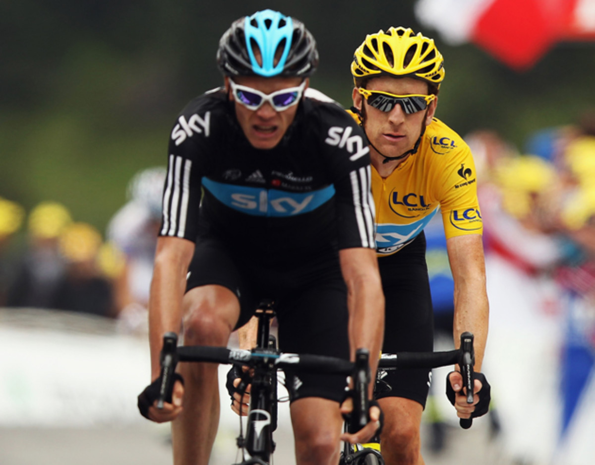 Chris Froome leads teammate and race leader Bradley Wiggins over the line on stage seventeen of the 2012 Tour de France from Bagneres-de-Luchon to Peyragudes.