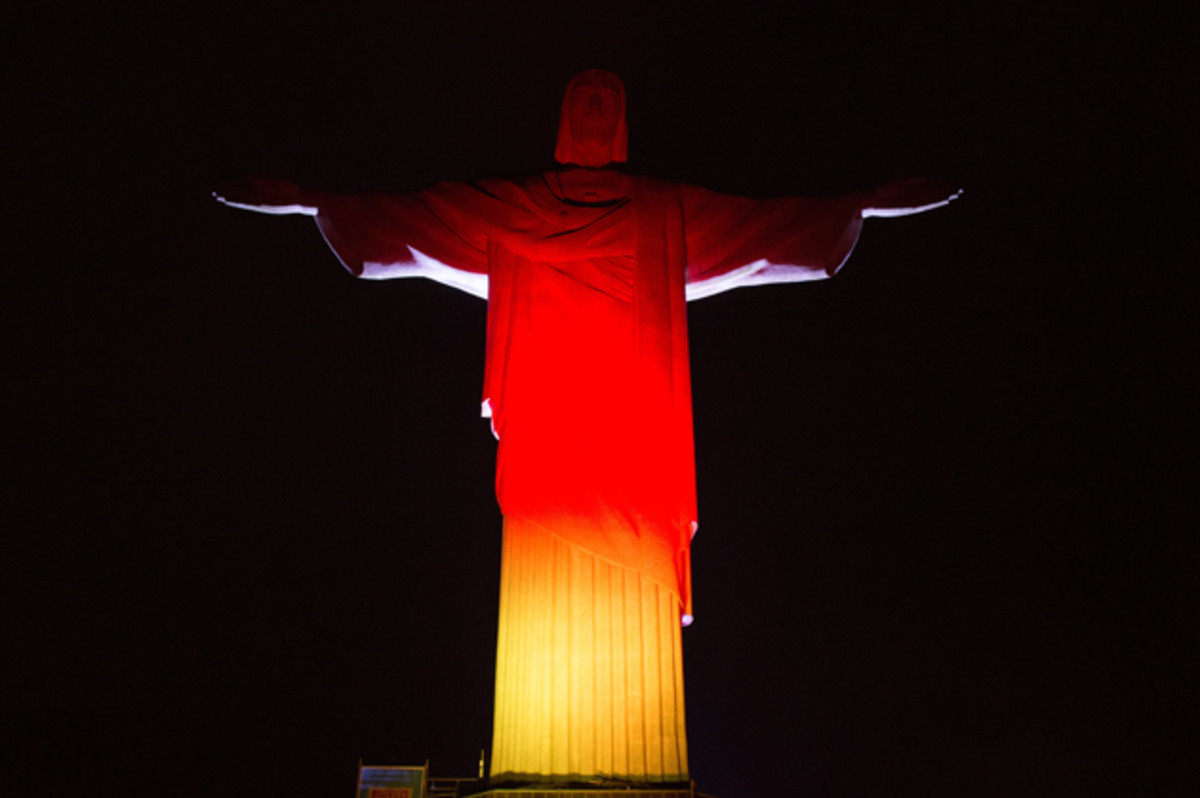 The Christ the Redeemer statue in Rio de Janeiro is illuminated in Germany's colors on the eve of the World Cup final.