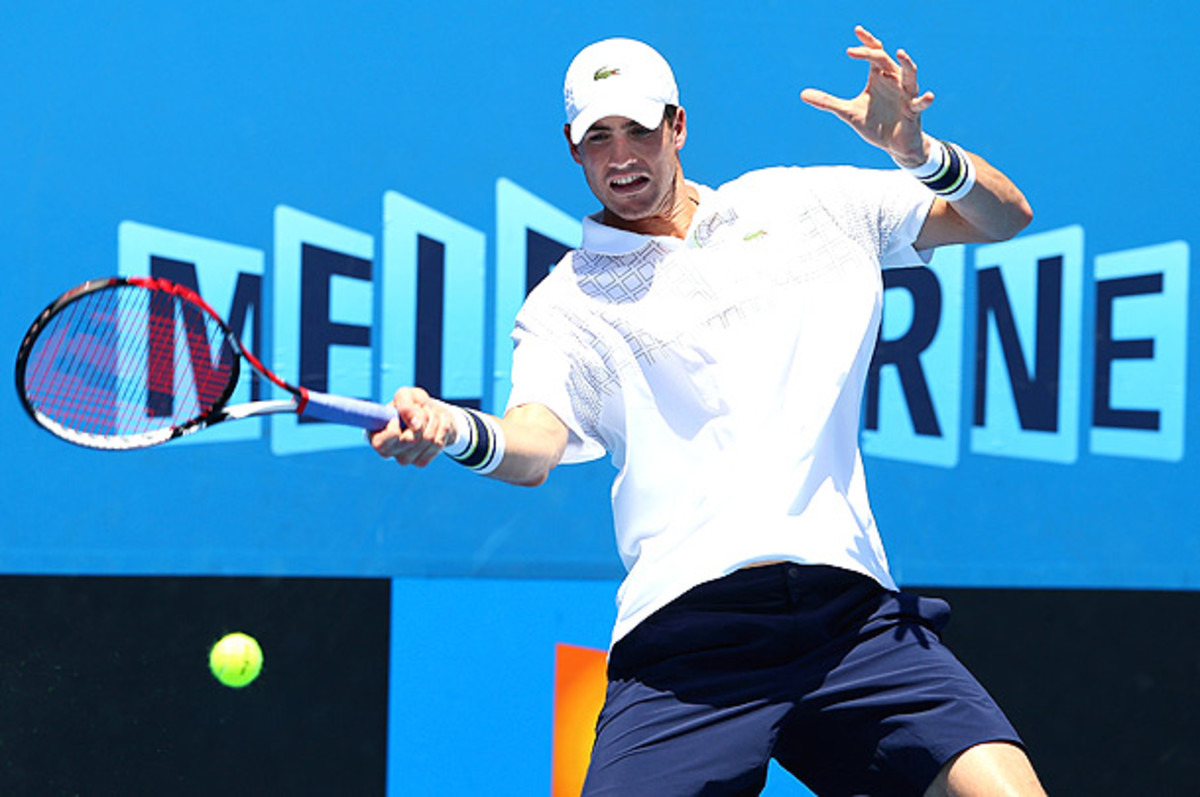 John Isner played through the pain to win the tournament in Auckland, but he couldn't bear it in Melbourne. (Robert Prezioso/Getty Images)