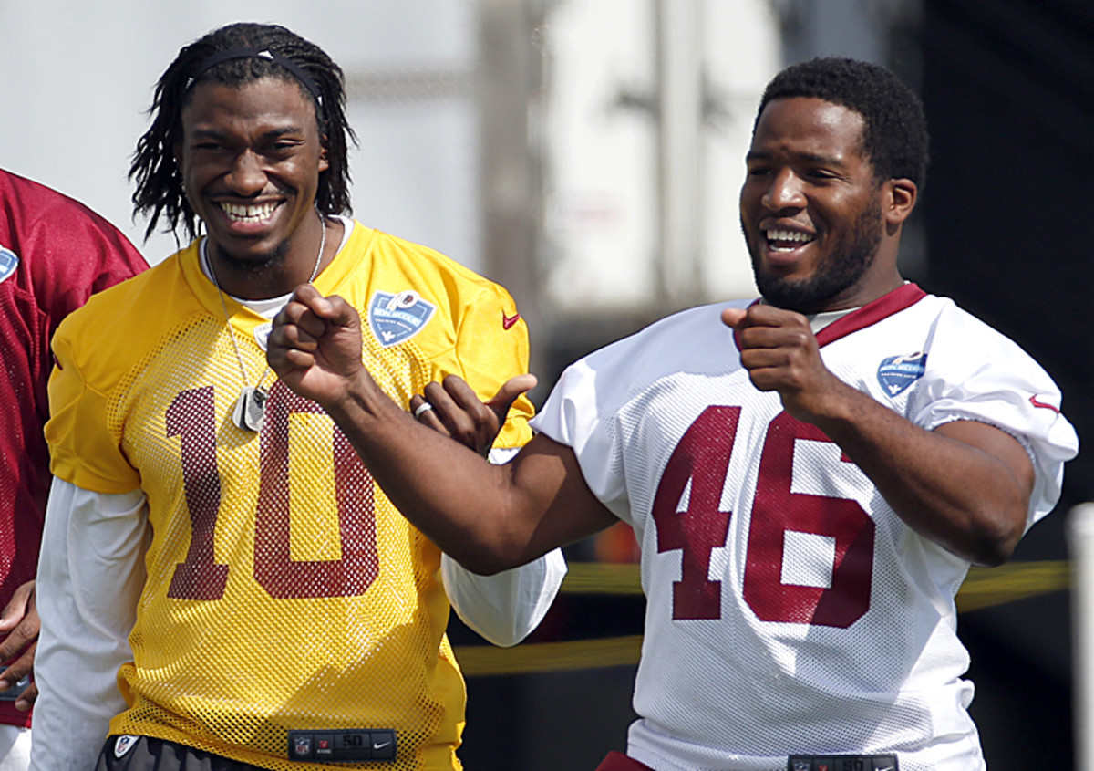 It will be up to Griffin (left) and RB Alfred Morris to drive Washington's new offense. (AP Photo)