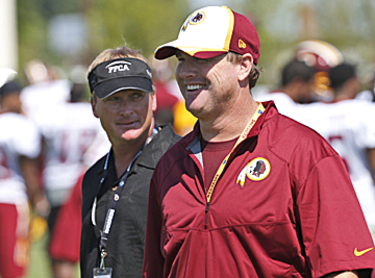 First-year head coach Jay Gruden was all smiles while big brother Jon looked on. (AP Photo)