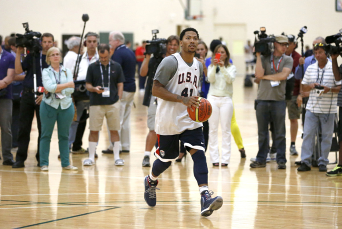 Reporters and photographers wait for Derrick Rose to finish his individual workout after a practice of the men's U.S. National basketball team in Chicago.