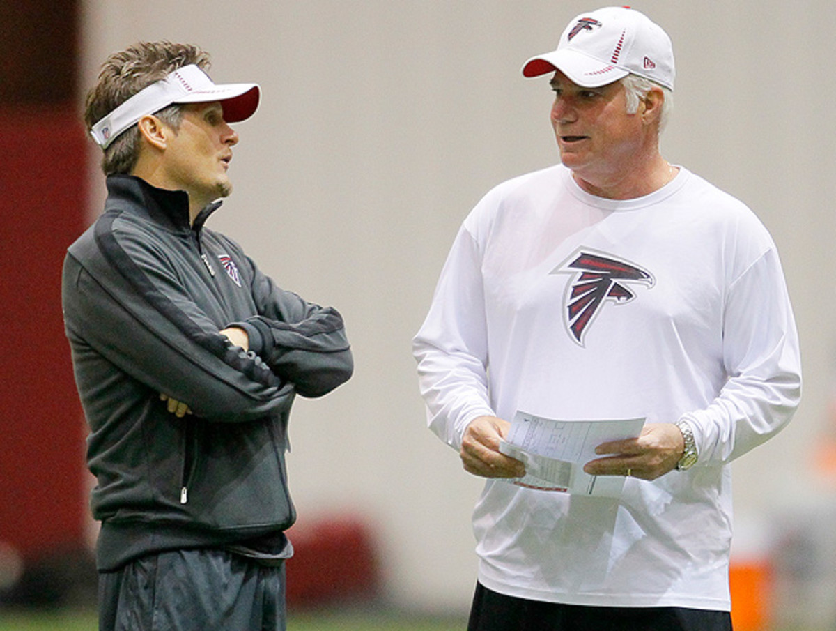 Thomas Dimitroff (left) and Falcons coach Mike Smith could benefit from either going up or down in the draft. (Todd Kirkland/Getty Images)