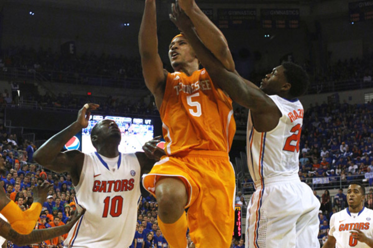 Dorian Finney-Smith (10) and Michael Frazier II helped the Gators keep Jarnell Stokes and the Volunteers off balance all game.