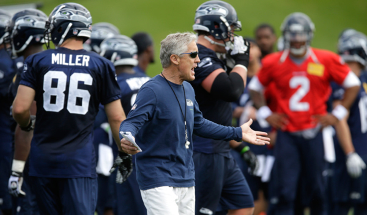 Pete Carroll's Seahawks hit the field for the first time since Super Bowl XLVIII. (Ted S. Warren/AP)