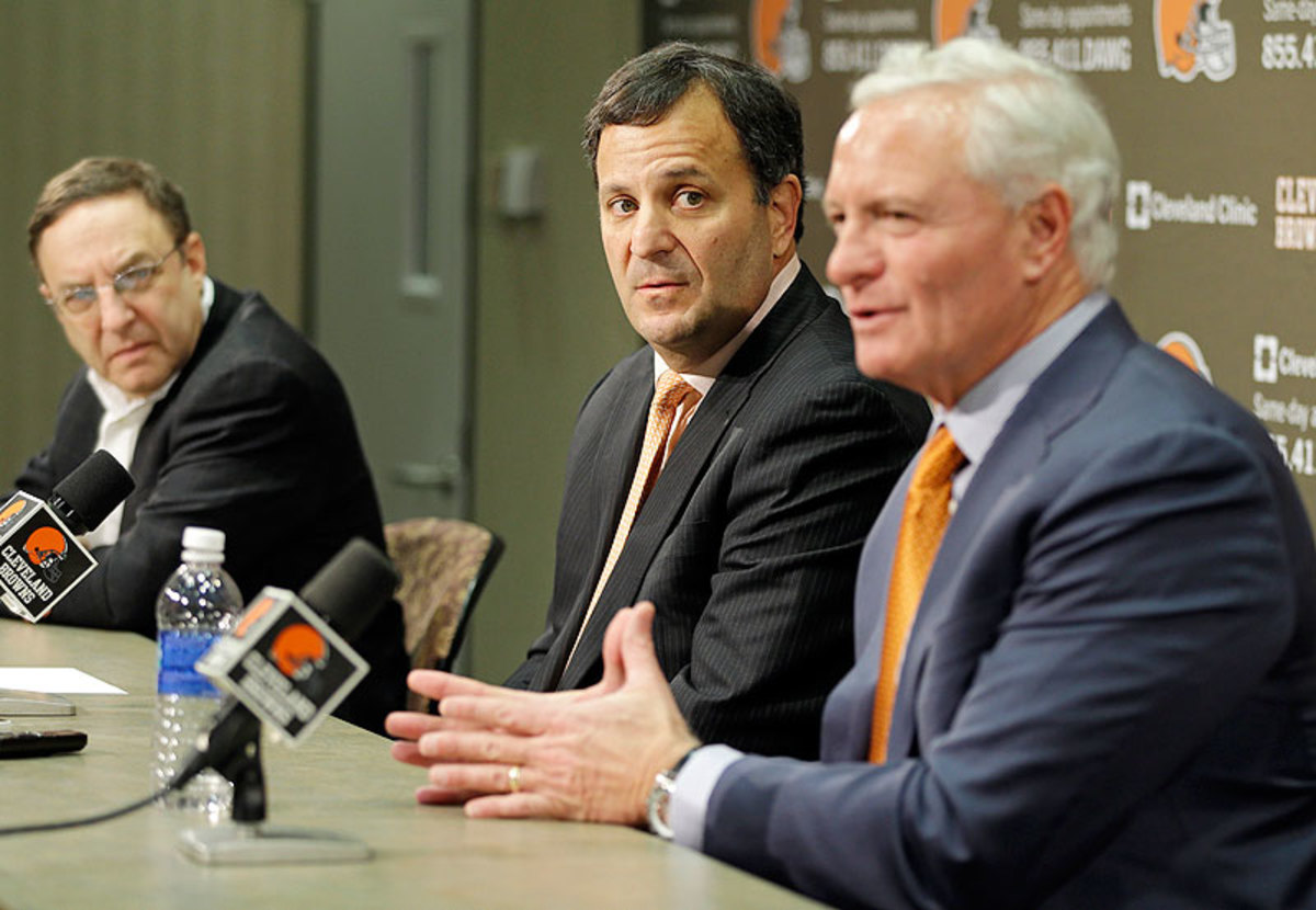 Mike Lombardi (center) rarely addressed the media, with Joe Banner and Jimmy Haslam speaking about the Browns' front-office decisions. (Mark Duncan/AP)