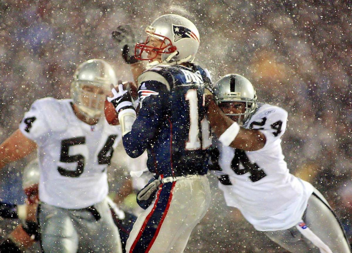 2002-Patriots-Raiders-Tom-Brady-Charles-Woodson-Tuck-Rule-snow.jpg