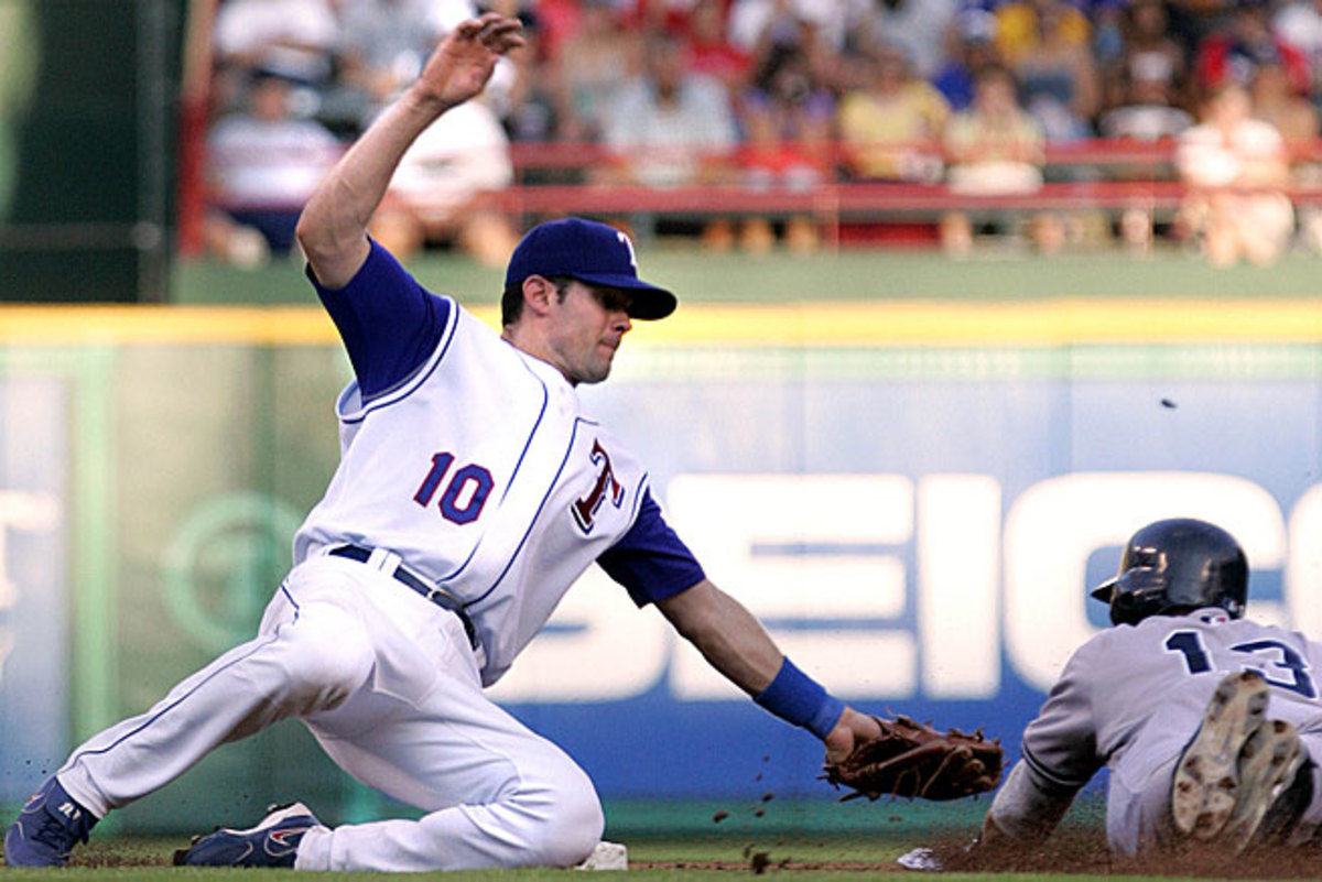 Michael Young (left), who will be honored by the B.A.T. on Tuesday, has kept a far lower-profile than fellow perennial All-Star and one-time teammate Alex Rodriguez.
