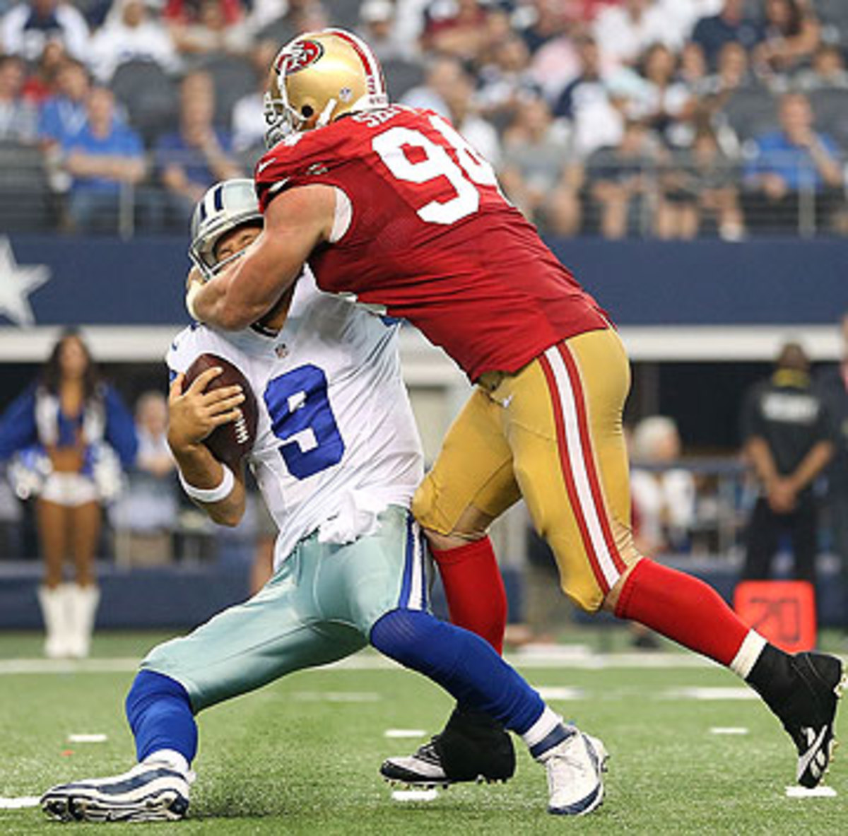 Tony Romo was sacked three times Sunday, twice by Justin Smith. (Christian Petersen/Getty Images)