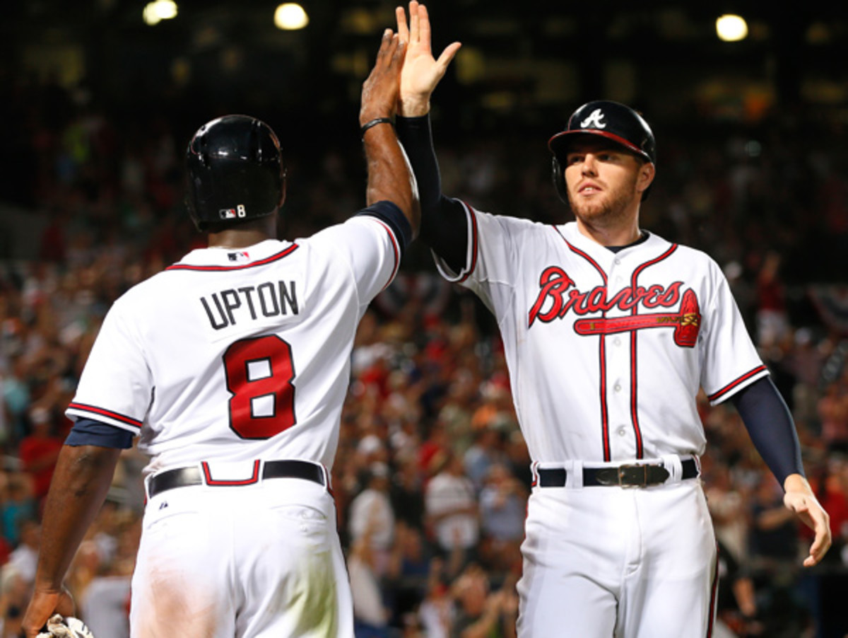 Justin Upton and Freddie Freeman lead a potent Atlanta offense. (Kevin C. Cox/Getty Images)