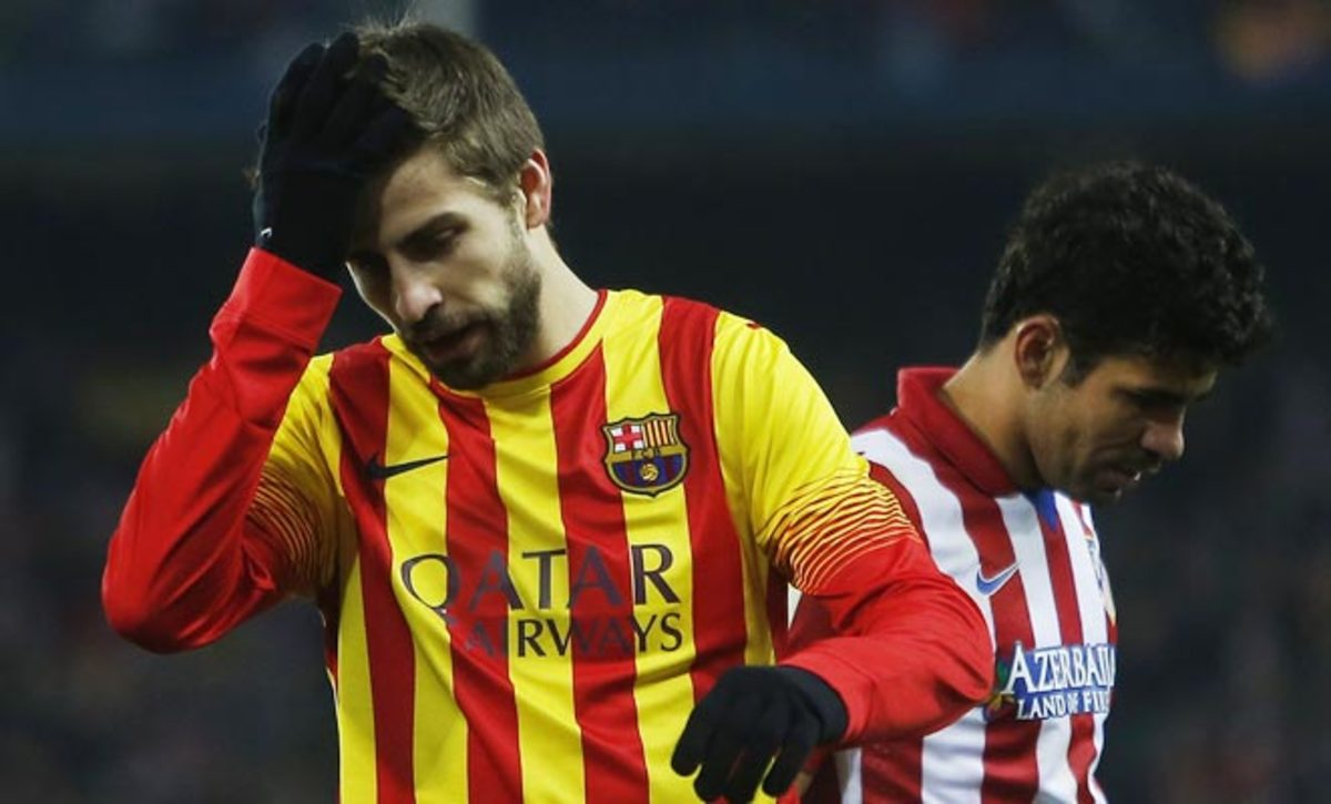 Barcelona's Gerard Pique (left) will miss two weeks with a leg injury.
