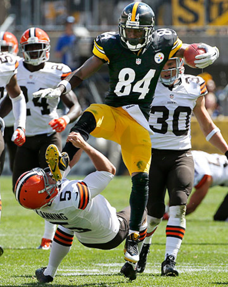 Antonio Brown was docked a 15-yard unnecessary roughness penalty for this play. (Gene J. Puskar/AP)