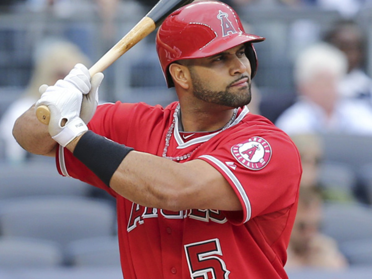 Albert Pujols has the third-most career homers hit by a Dominican-born player. (John Minchillo/AP)