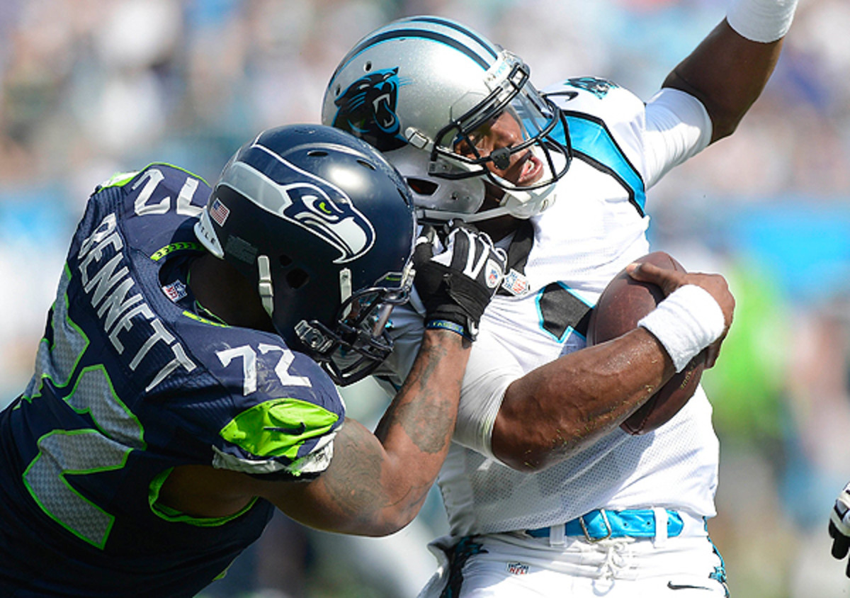 Michael Bennett gets to Cam Newton in the Seahawks' season-opener. (Charlotte Observer/Getty Images)
