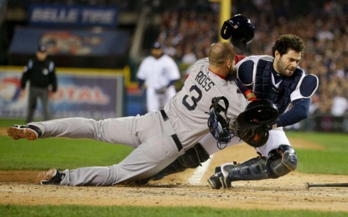 Boston Red Sox's David Ross rams into Detroit Tigers catcher Alex Avila in last year's ALCS. (AP Photo/Matt Slocum)
