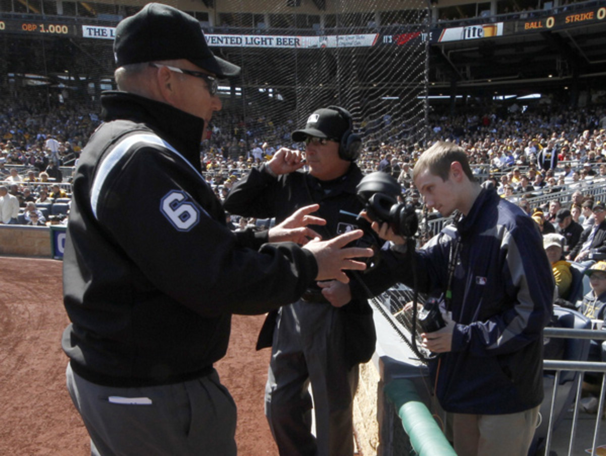Bob Davidson (left) and the umpire crew review a play during Monday's game. (Gene Puskar/AP)