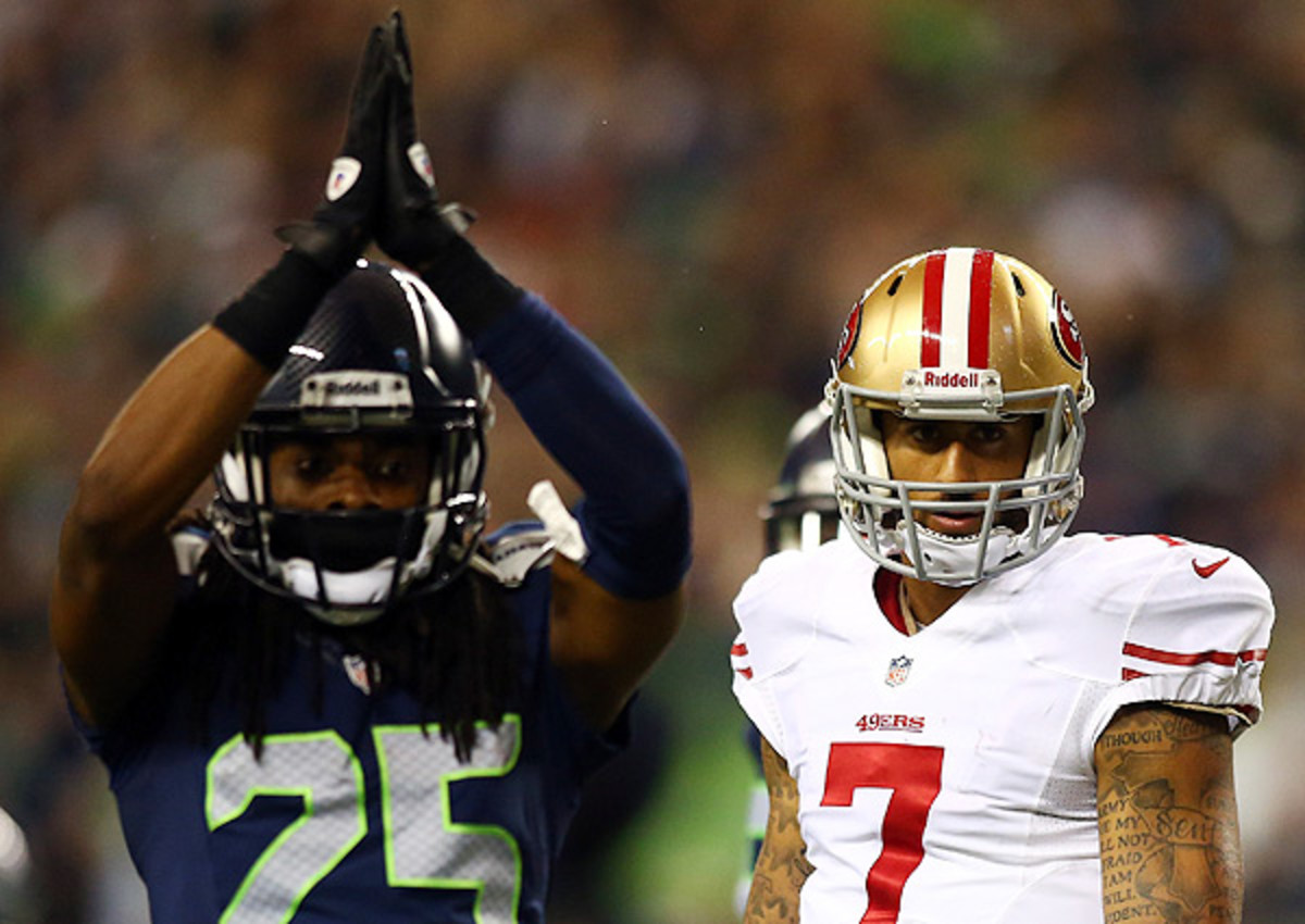 'If I throw it [the ball] a foot farther ... now you're the goat, Richard Sherman,' said Colin Kaepernick (right).