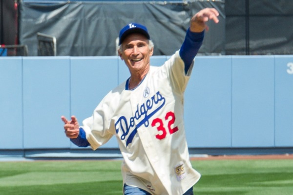 Sandy Koufax threw out the first pitch for Dodgers opening day last season. (Noel Vasquez/Getty Images)