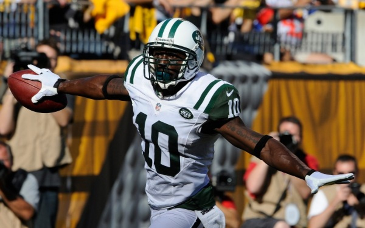 Jets receiver Santonio Holmes could miss part of training camp because of a lingering foot injury. (Joe Sargent/Getty Images)