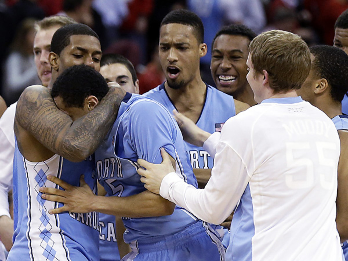 No. 19 UNC had plenty to celebrate after Marcus Paige (center) saved them from an upset in Raleigh. (Gerry Broome/AP)