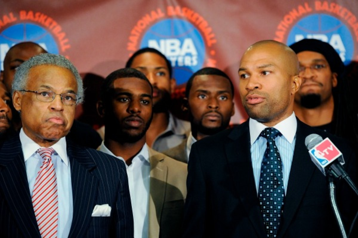 Derek Fisher (right) was among NBPA members who voted executive director Billy Hunter out of office. (Patrick McDermott/Getty Images)