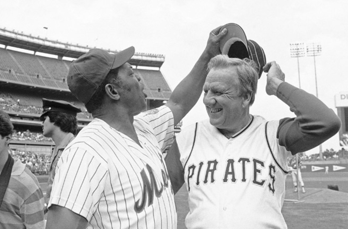 Baseball Hall of Fame slugger Ralph Kiner, right, (with Willie Mays) died at his home in California on Thursday. He was 91.