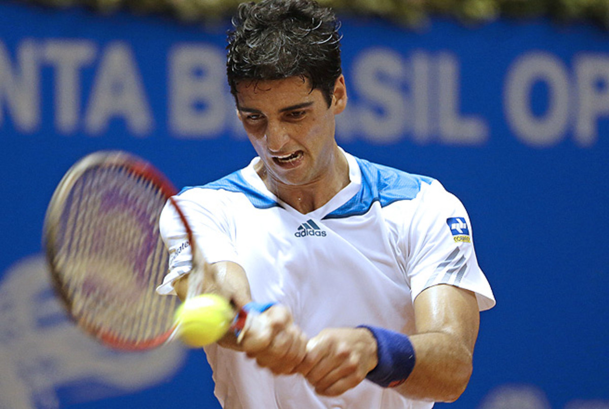 Thomaz Bellucci, who received a wild-card entry, upset No. 8-seed Santiago Giraldo 4-6, 7-5, 6-3.