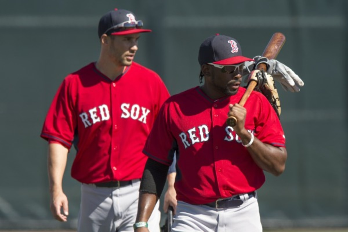 The veteran Grady Sizemore (left) beat out prospect Jackie Bradley Jr. (right). (Michael Ivins/Getty Images)