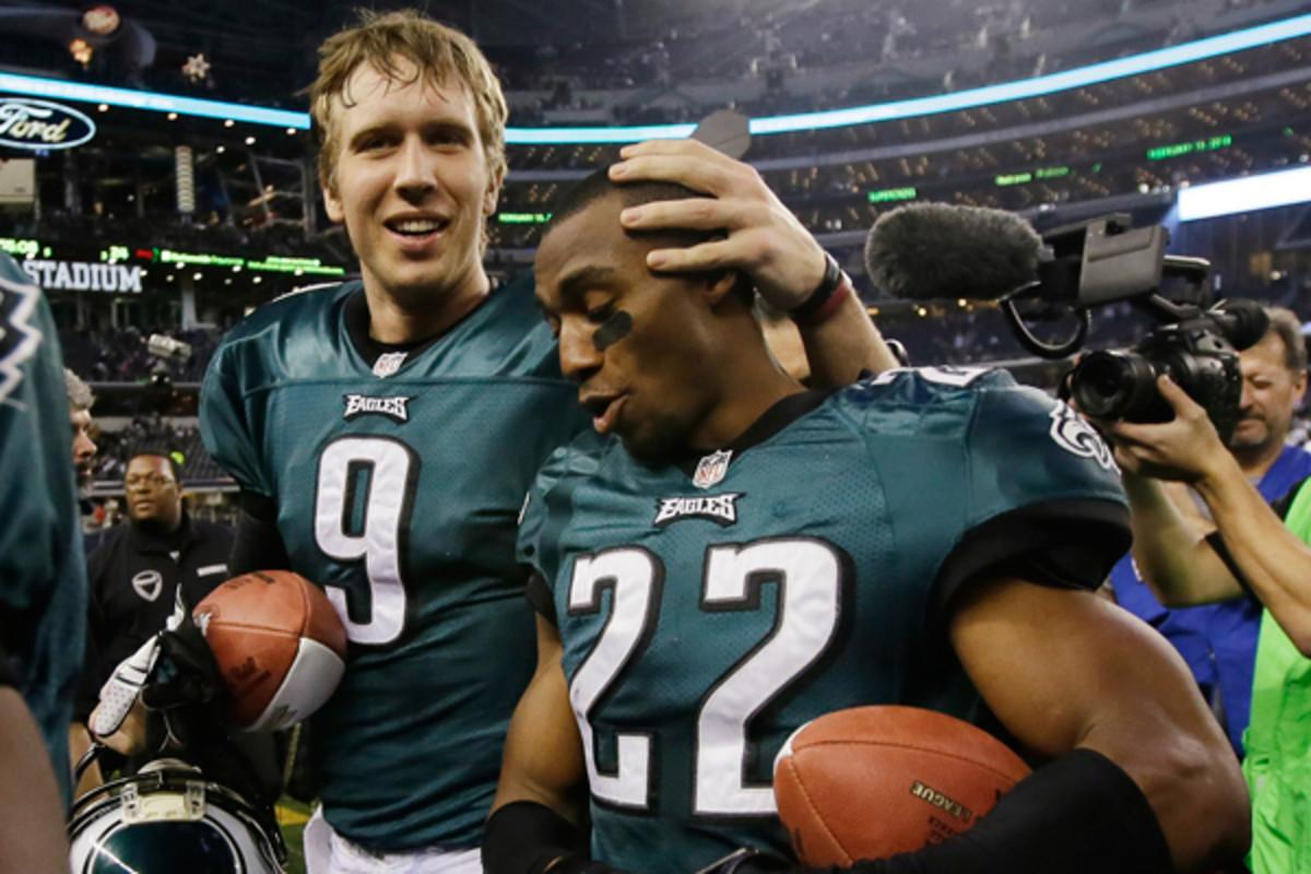 Quarterback Nick Foles and running back LeSean McCoy celebrate the Eagles' NFC East title. (Tony Gutierrez/AP)