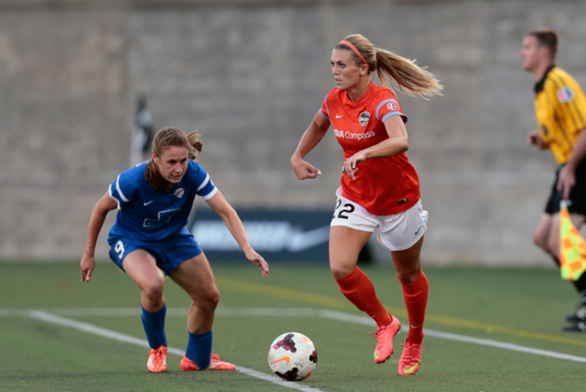 Boston Breakers and veteran U.S. women's national team star Heather O'Reilly challenges the Houston Dash's Stephanie Ochs in NWSL action last weekend.
