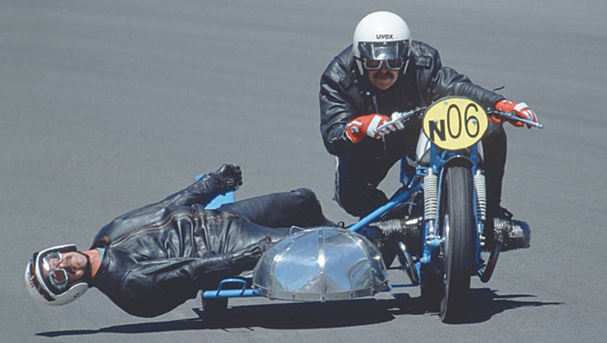 George Guski skims the surface as Herbert Grod drives their 1955 BMW into a turn during a vintage sidecar race at the 'Ring.