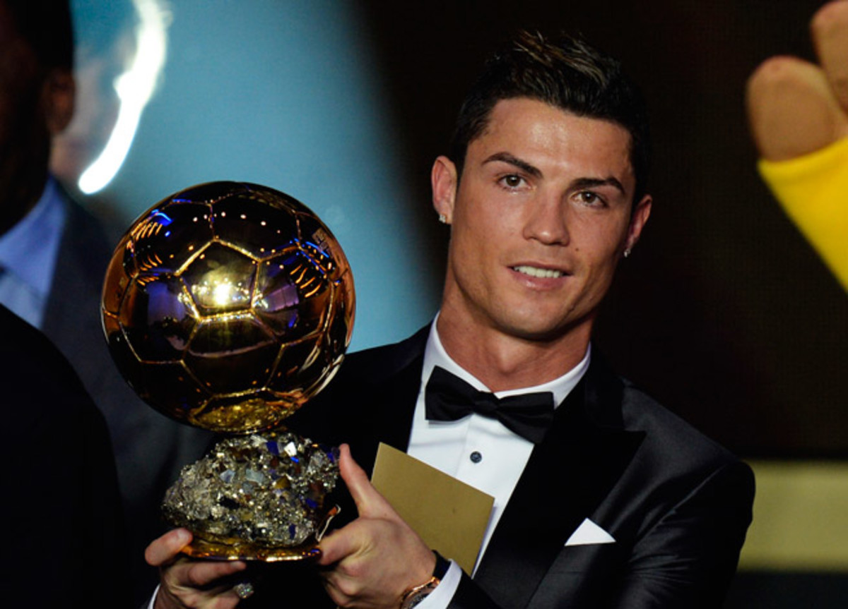 Cristiano Ronaldo hoists the FIFA Ballon d'Or for the second time in his career, ending Lionel Messi's four-year run.