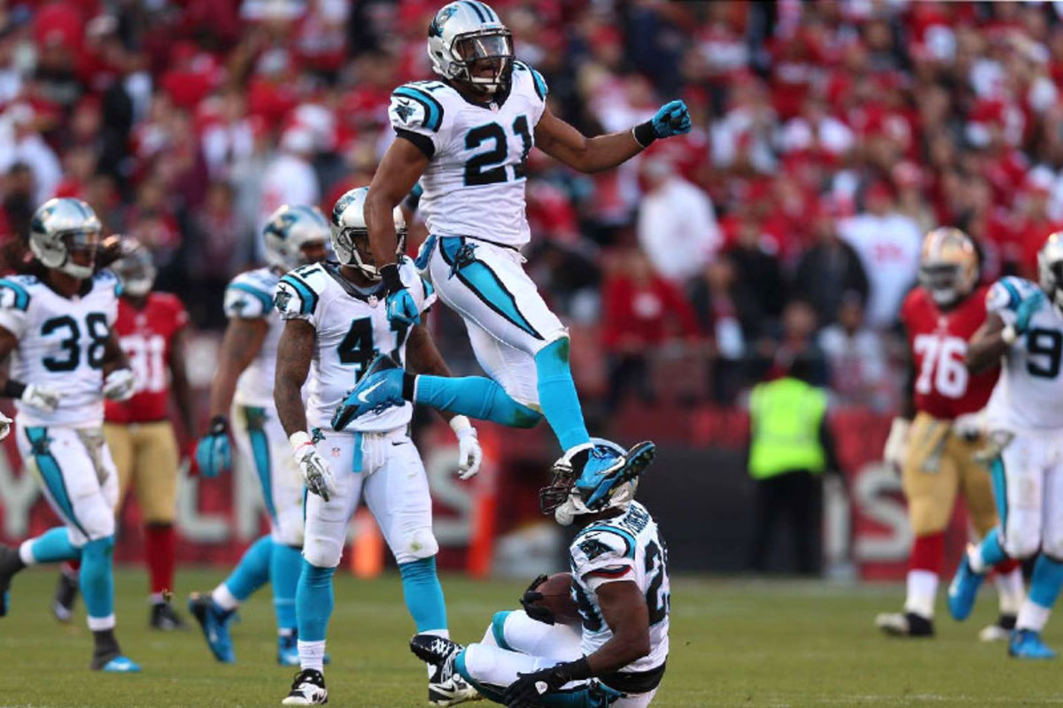 Carolina's Mike Mitchell (21) may be walking on air—and walking away from Carolina—given the demand for proven safeties. (Jed Jacobsohn/SI/The MMQB)